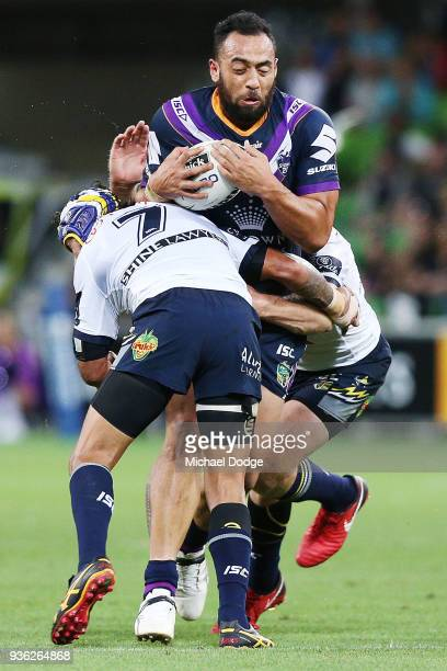 Sam Kasiano of the Storm is tackled by Johnathan Thurston of the Cowboys during the round three NRL match between the Melbourne Storm and the North...