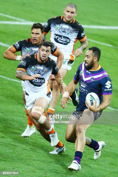 Sam Kasiano of the Storm runs with the ball during the round two NRL match between the Melbourne Storm and the Wests Tigers at AAMI Park on March 17...