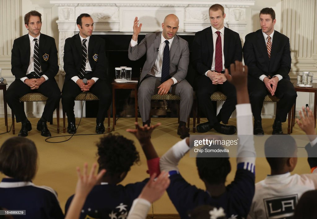 Sam Kass (C), Assistant White House Chef and Executive Director of first lady Michelle Obama's health program 'Let's Move!,' hosts a question-and-answer session with (L-R) Major League Soccer champion Los Angeles Galaxy players Mike Magee and Landon Donovan and National Hockey League Stanley Cup winning Los Angeles Kings Dustin Brown and Rob Scuderi in the State Dining Room of the White House March 26, 2013 in Washington, DC. The White House says the children participating in the clinic come from soccer and hockey programs in Philadelphia, Atlanta, Boston, Cleveland, Columbus, Ohio, Detroit and Washington, D.C.