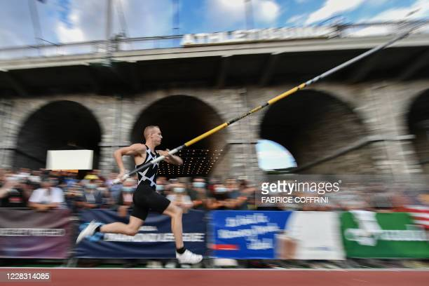 Sam Kendricks competes during a men's pole vaulting exhibition street event of the Diamond League athletics meeting Athletissima on September 2, 2020...