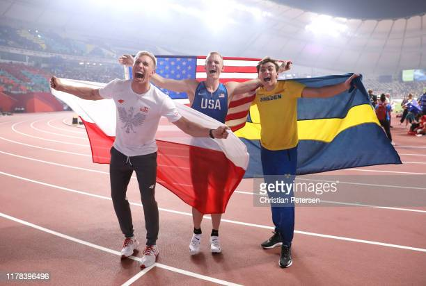 Sam Kendricks of the United States gold Armand Duplantis of Sweden silver and Piotr Lisek of Poland bronze celebrate after the Men's Pole Vault final...