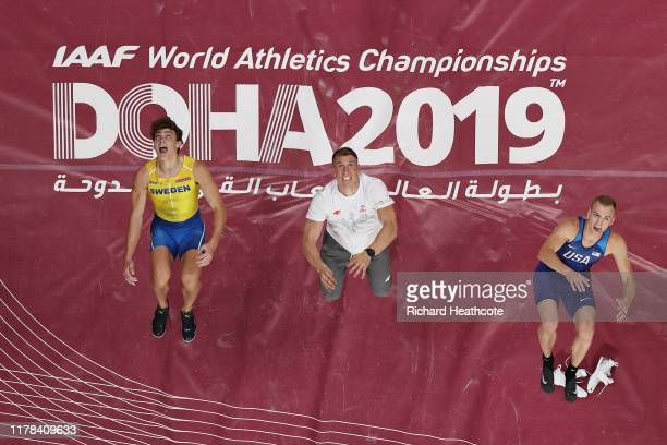 Sam Kendricks of the United States gold Armand Duplantis of Sweden silver and Piotr Lisek of Poland bronze celebrate with a flip after the Men's Pole...