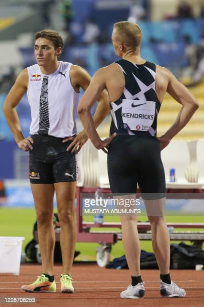 Sam Kendricks speaks with Sweden's Armand Duplantis during the Men's pole vault during the IAAF Diamond League competition on September 25, 2020 at...