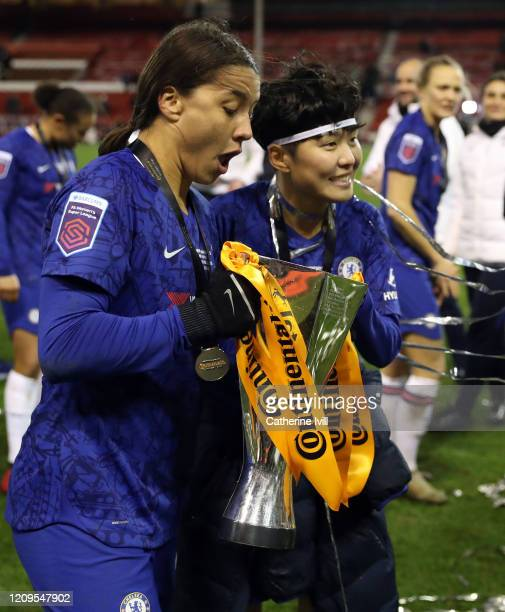 Sam Kerr and Ji SoYun of Chelsea celebrate with the trophy after the FA Women's Continental League Cup Final Chelsea FC Women and Arsenal FC Women at...