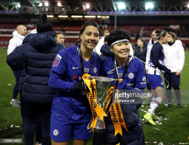 Sam Kerr and Ji Soyun of Chelsea celebrate with the trophy following the FA Women's Continental League Cup Final Chelsea FC Women and Arsenal FC...