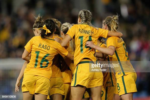 Sam Kerr of Australia celebrates her goal with team mates during the Women's International match between the Australian Matildas and Brazil at...