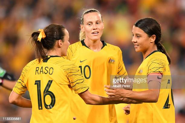 Sam Kerr of Australia celebrates with team mates after scoring her side's third goal during the 2019 Cup of Nations match between Australia and the...