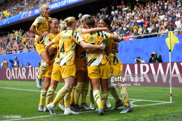 Sam Kerr of Australia celebrates with teammates after scoring her team's first goal during the 2019 FIFA Women's World Cup France group C match...