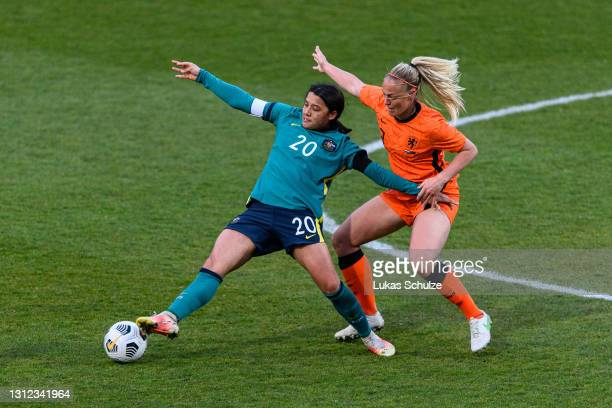 Sam Kerr of Australia challenges for the ball with Stefanie van der Gragt of Netherlands during the International Friendly between Netherlands and...