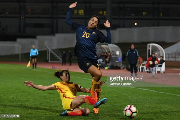 Sam Kerr of Australia competes for the ball with Wu Haiyan of China during the Women's Algarve Cup Tournament match between Australia and China at...