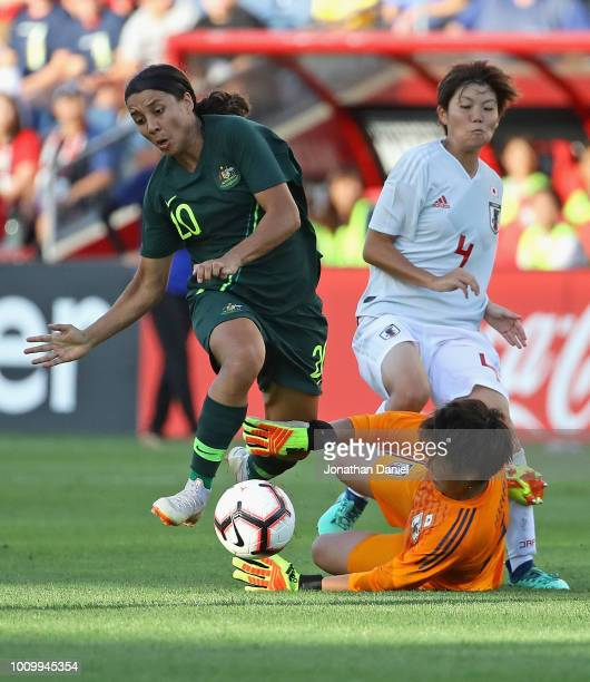 Sam Kerr of Australia gets the ball around Sakiko Ikeda of Japan on her way to scoring a goal during the 2018 Tournament Of Nations at Toyota Park on...