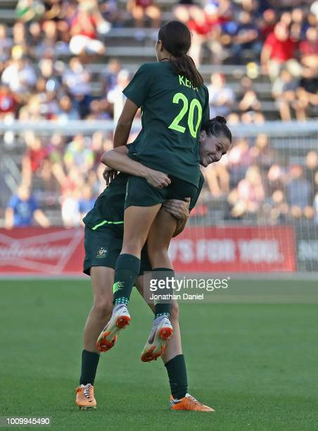 Sam Kerr of Australia is lifted by teammate Emily Gielink after scoring a goal against Japan during the 2018 Tournament Of Nations at Toyota Park on...
