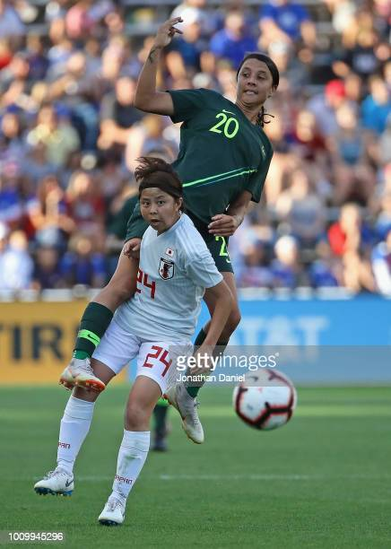 Sam Kerr of Australia lands on top of Narumi Miura of Japan during the 2018 Tournament Of Nations at Toyota Park on August 2 2018 in Bridgeview...