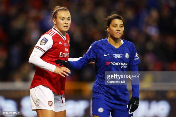 Sam Kerr of Chelsea and fellow Australian Caitlin Foord of Arsenal look on during the FA Women's Continental League Cup Final Chelsea FC Women and...