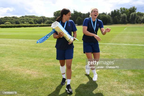 Sam Kerr of Chelsea and Millie Bright of Chelsea celebrate with the Barclays FA Women's Super League trophy following a Chelsea FC Women's Training...