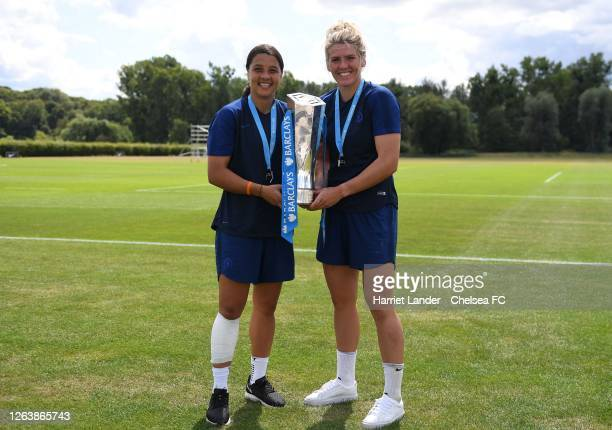 Sam Kerr of Chelsea and Millie Bright of Chelsea pose for a photo with the Barclays FA Women's Super League trophy following a Chelsea FC Women's...