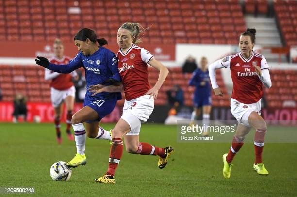 Sam Kerr of Chelsea is challenged by Louise Quinn of Arsenal during the FA Women's Continental League Cup Final Chelsea FC Women and Arsenal FC Women...