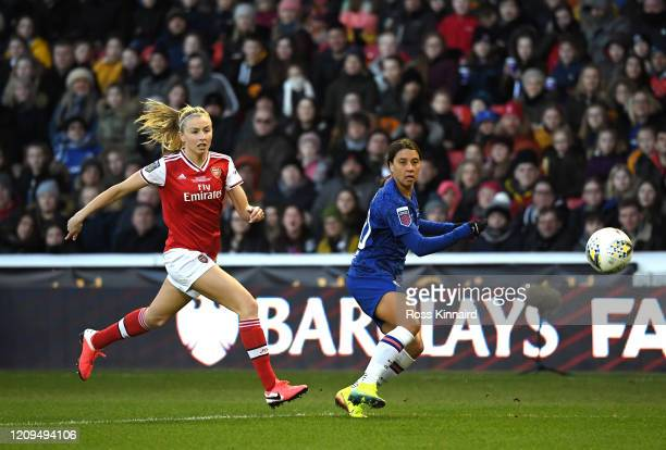 Sam Kerr of Chelsea shoots as she is put under pressure by Leah Williamson of Arsenal during the FA Women's Continental League Cup Final Chelsea FC...