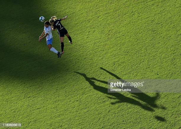 Sam Kerr of Chicago Red Stars goes up for a ball against McCall Zerboni of North Carolina Courage during the 2019 NWSL Championship game at WakeMed...