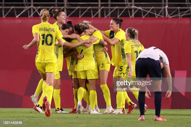 Sam Kerr of Team Australia celebrates with team mates after scoring their side's second goal during the Women's Quarter Final match between Great...