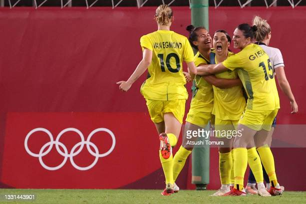 Sam Kerr of Team Australia celebrates with team mates after scoring their side's fourth goal during the Women's Quarter Final match between Great...