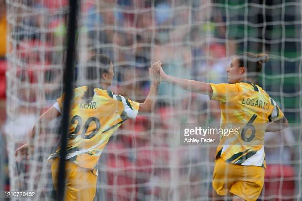 Sam Kerr of the Australian Matildas celebrates her goal with Chloe Logarzo during the Women's Olympic Football Tournament PlayOff match between the...