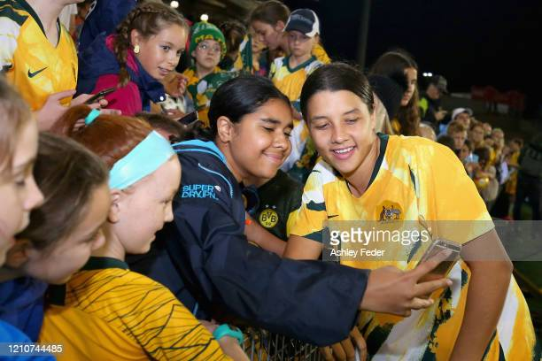 Sam Kerr of the Australian Matildas celebrates the win with fans during the Women's Olympic Football Tournament PlayOff match between the Australian...