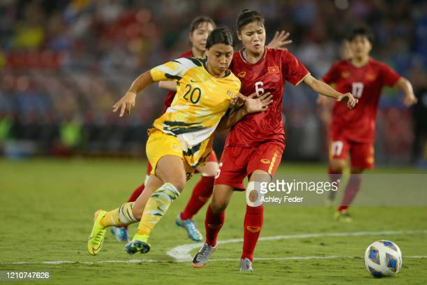 Sam Kerr of the Australian Matildas contests the ball against Luong Thi Thu Thuong of Vietnam during the Women's Olympic Football Tournament PlayOff...