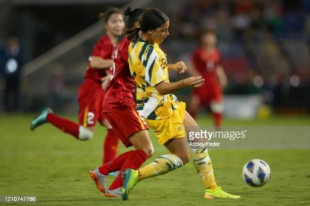 Sam Kerr of the Australian Matildas controls the ball during the Women's Olympic Football Tournament PlayOff match between the Australian Matildas...