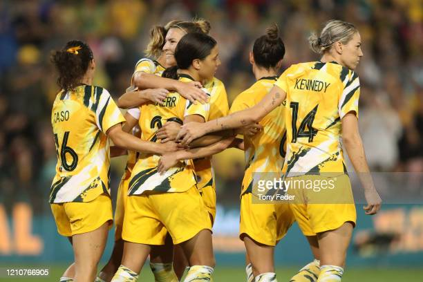 Sam Kerr of the Australian Matildas is congratulated by team mates after scoring a goal during the Women's Olympic Football Tournament PlayOff match...