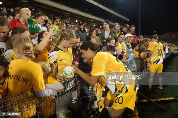 Sam Kerr of the Australian Matildas with fans during the Women's Olympic Football Tournament PlayOff match between the Australian Matildas and...
