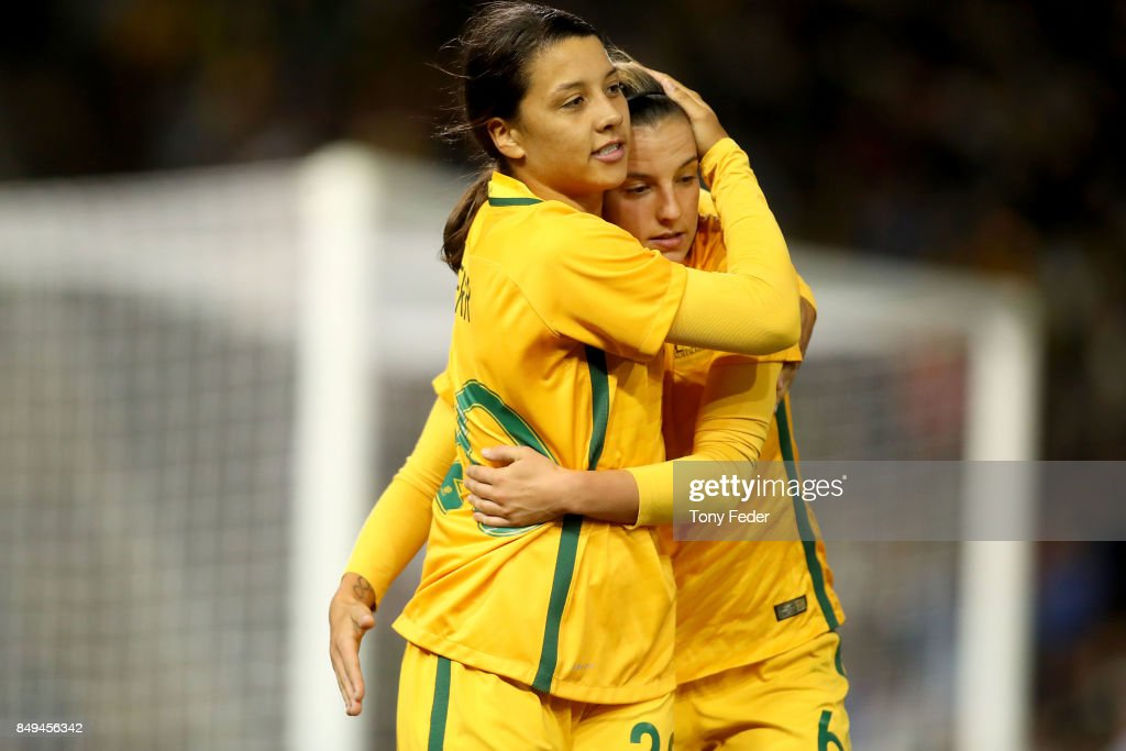 Sam Kerr of the Matildas celebrates a goal with team mate Chloe Logarzo during the Women's International match between the Australian Matildas and Brazil at McDonald Jones Stadium on September 19, 2017 in Newcastle, Australia.