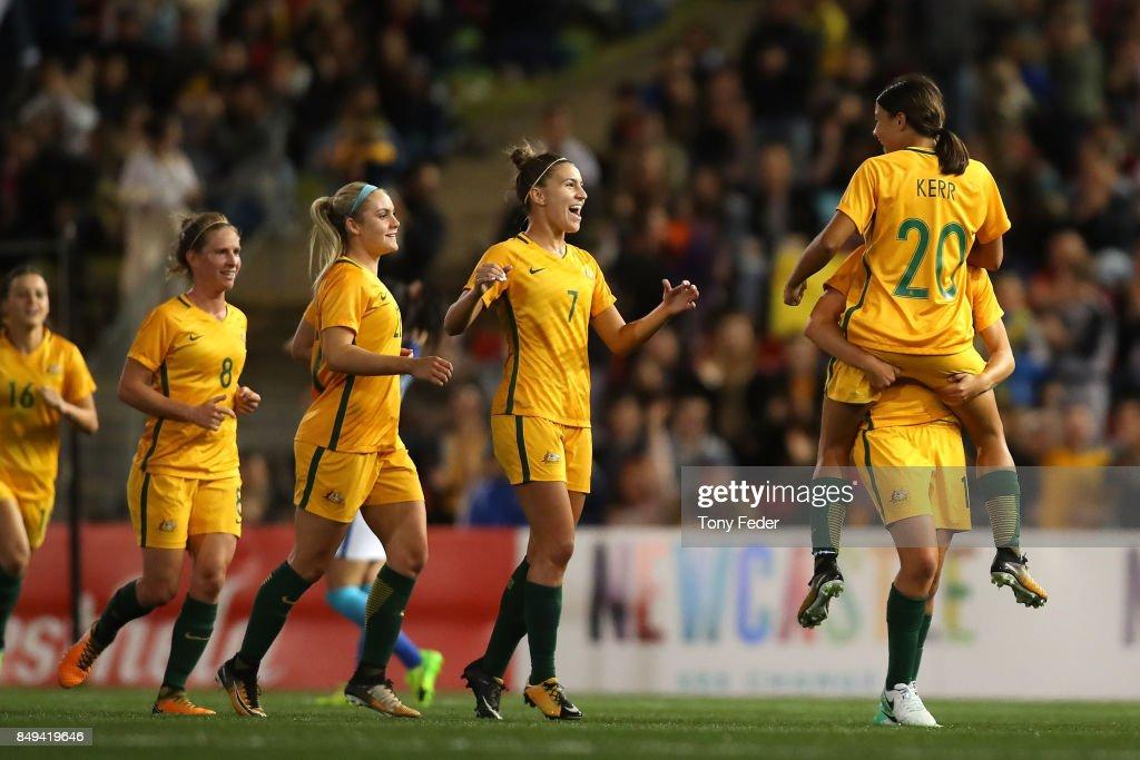 Sam Kerr of the Matildas celebrates a goal with team mate Emily Van Egmond during the Women's International match between the Australian Matildas and Brazil at McDonald Jones Stadium on September 19, 2017 in Newcastle, Australia.