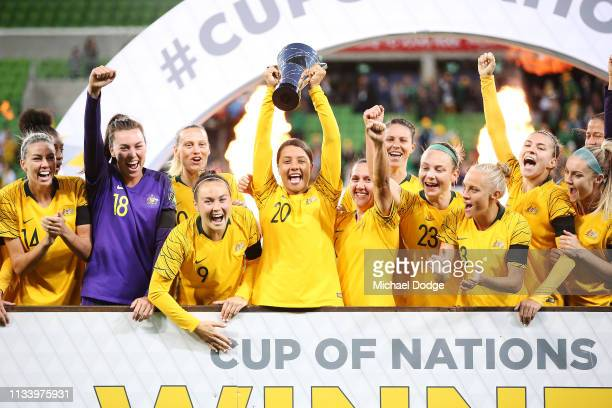 Sam Kerr of the Matildas lifts up the trophy and celebrates the win with teammates during the Cup of Nations match between Australia and Argentina at...