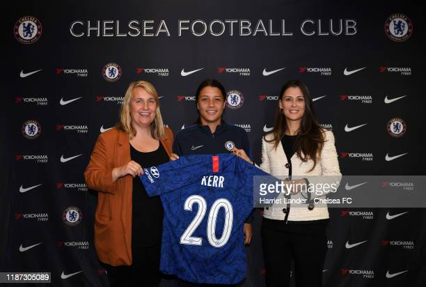 Sam Kerr poses for a photo with Emma Hayes Manager of Chelsea and Marina Granovskaia Director of Chelsea as she signs for Chelsea Women FC at...