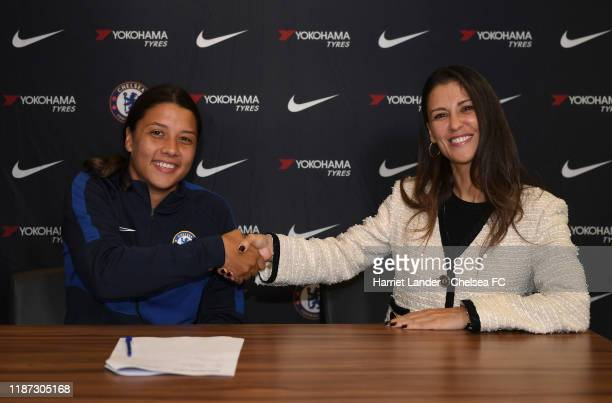 Sam Kerr shakes hands with Marina Granovskaia Director of Chelsea as she signs for Chelsea Women FC at Stamford Bridge on November 13 2019 in London...