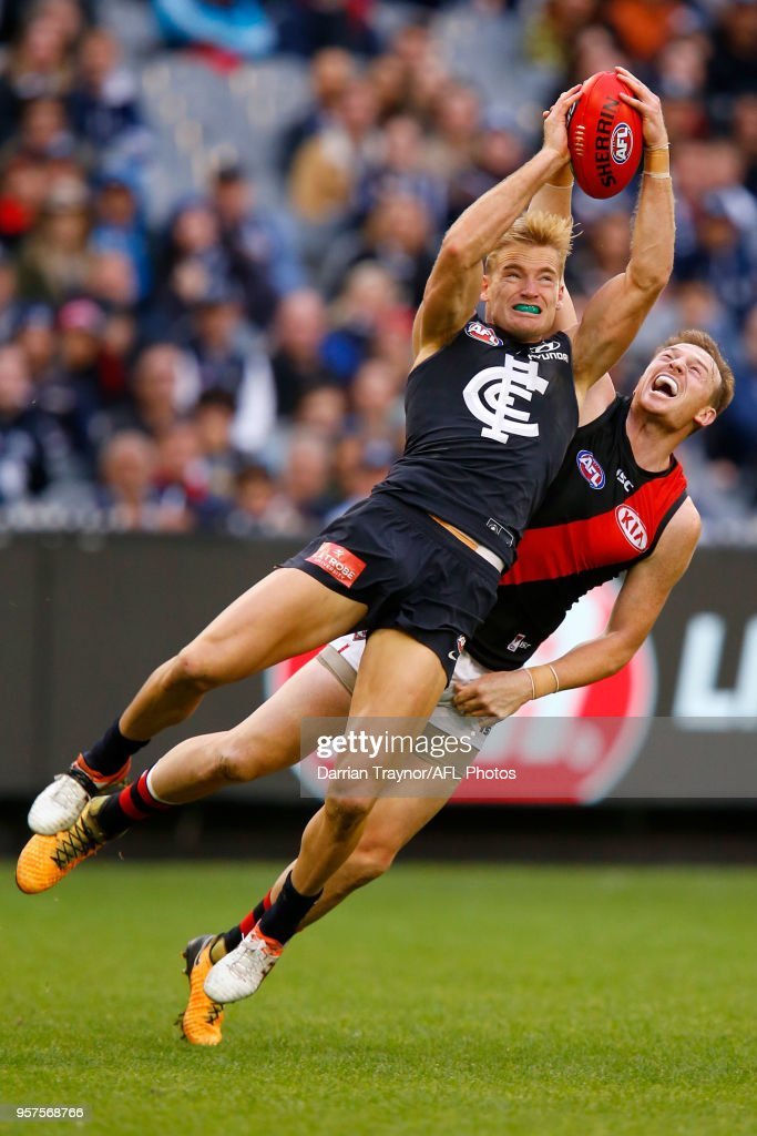 Sam Kerridge of the Blues mark in front of Brendon Goddard of the Bombers during the round eight AFL match between the Carlton Blues and the Essendon Bombers at Melbourne Cricket Ground on May 12, 2018 in Melbourne, Australia.
