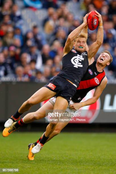 Sam Kerridge of the Blues mark in front of Brendon Goddard of the Bombers during the round eight AFL match between the Carlton Blues and the Essendon...