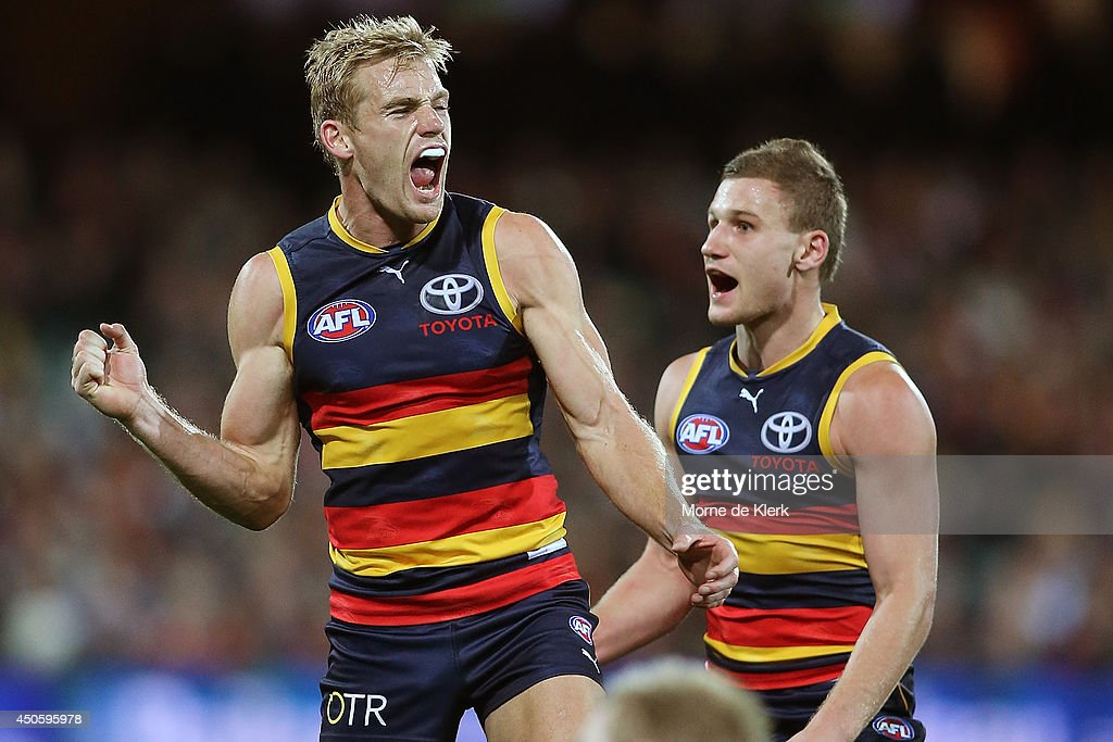 Sam Kerridge (L) of the Crows celebrates after kicking a goal during the round 13 AFL match between the Adelaide Crows and the North Melbourne Kangaroos at Adelaide Oval on June 14, 2014 in Adelaide, Australia.