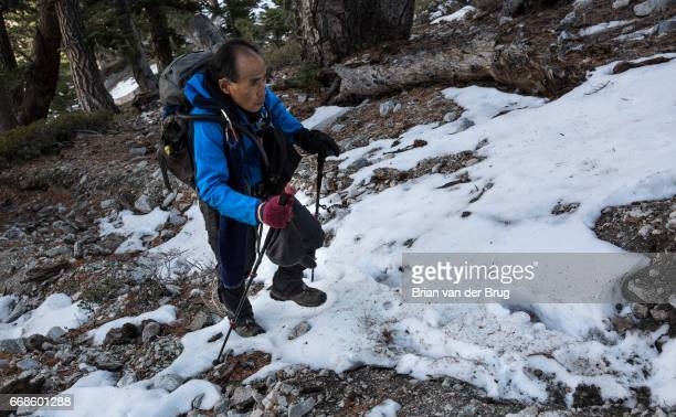 MT BALDY CALIF WEDNESDAY DECEMBER 14 2016 Sam Kim hikes off trail up a steep snowy slope on the approach to Mt Baldy a trek he has made more than 700...
