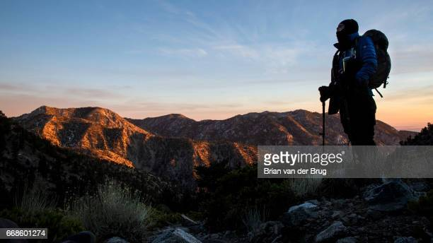 MT BALDY CALIF WEDNESDAY DECEMBER 14 2016 Sam Kim takes in the sunset light bathing the shoulders of the San Gabriel Mountains on hike down from the...