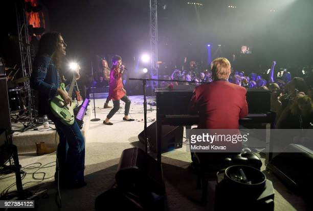 Sam Kiszka and Josh Kiszka of Greta Van Fleet perform onstage with Sir Elton John during the 26th annual Elton John AIDS Foundation Academy Awards...