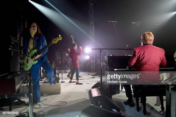 Sam Kiszka and Josh Kiszka of Greta Van Fleet perform onstage with Sir Elton John during the 26th annual Elton John AIDS Foundation Academy Awards...