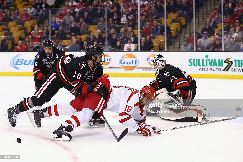 Sam Kurker #10 of the Northeastern Huskies and Jordan Greenway #18 of the Boston University Terriers collide during the third period at TD Garden on February 1, 2016 in Boston, Massachusetts. The Terriers defeat the Huskies 3-1.