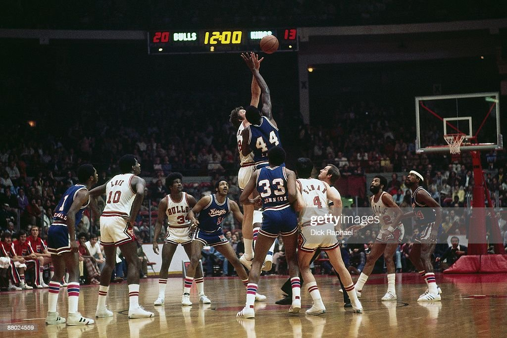 Sam Lacey #44 of the Kansas City Kings battles for a jump ball against the Boston Celtics during a game played in 1975 at Chicago Stadium in Chicago, Illinois.