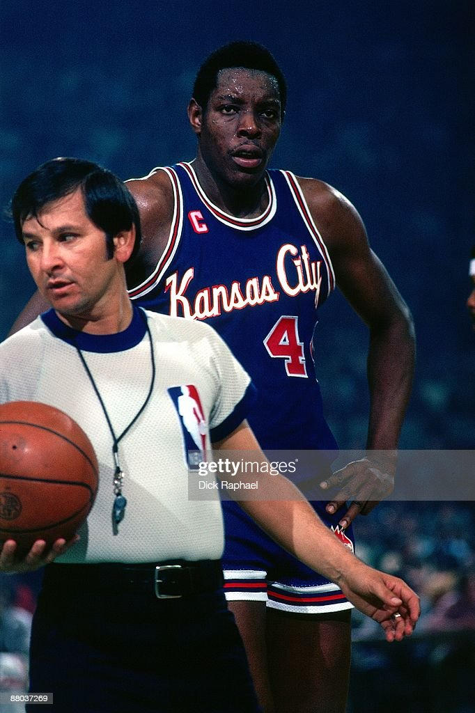 Sam Lacey #44 of the Kansas City Kings stands with a referee during a game played against the Boston Celtics in 1976 at the Boston Garden in Boston, Massachusetts.