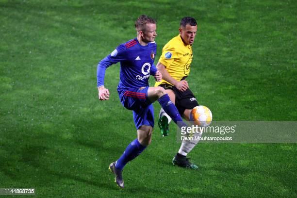 Sam Larsson of Feynoord Rotterdam is tackled by Giovanni Korte of NAC Breda during the Eredivisie match between NAC Breda and Feyenoord at Rat...