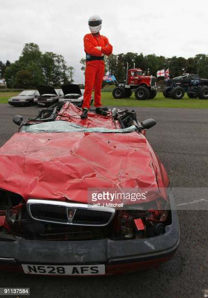 Sam Law stands on a crushed car after giving a demonstration the monster trucks car crushing abilities at the Museum of Flight on September 25 2009...