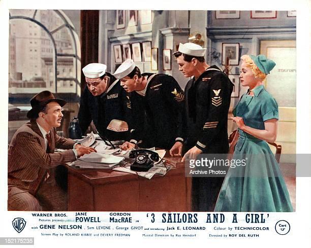 Sam Levene addressing Jack E Leonard Gene Nelson Gordon MacRae and Jane Powell in a scene from the film 'Three Sailors And A Girl' 1953