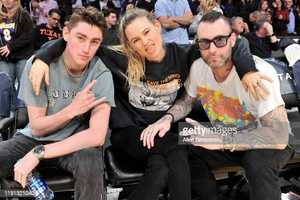 Sam Levine, Behati Prinsloo and Adam Levine attend a basketball game between the Los Angeles Lakers and the Dallas Mavericks at Staples Center on...